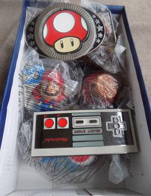 Box of Mario collectables including 2 belt buckles