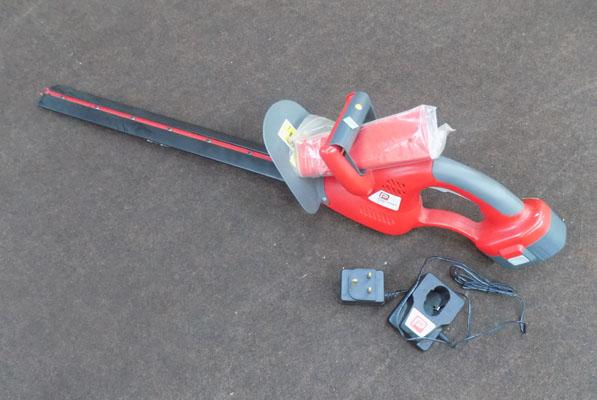 Battery operated hedge trimmo with charger