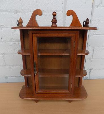 Small glass fronted display cabinet