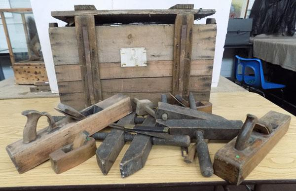 Box of wooden shoe making equipment, in wooden transport box
