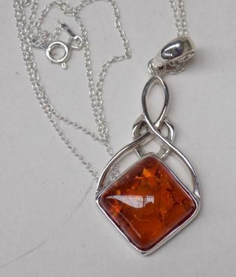 Silver & amber set pendant on silver chain