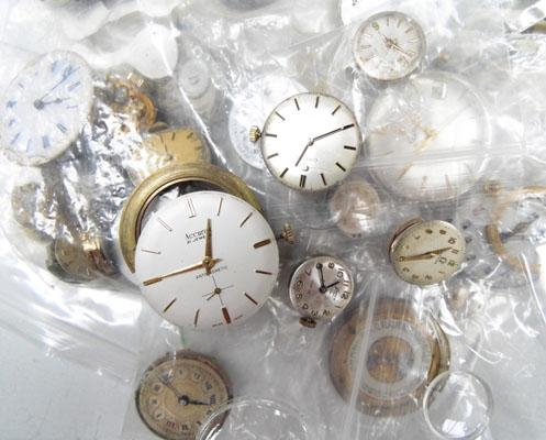 Bag of assorted watch parts