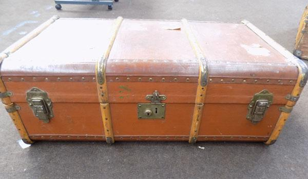 Light brown travel trunk