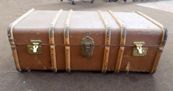 Dark brown travel trunk