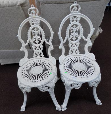 2 wrought iron garden chairs