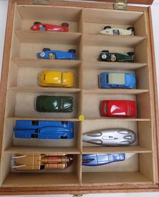 Display case of 12 collectable cars