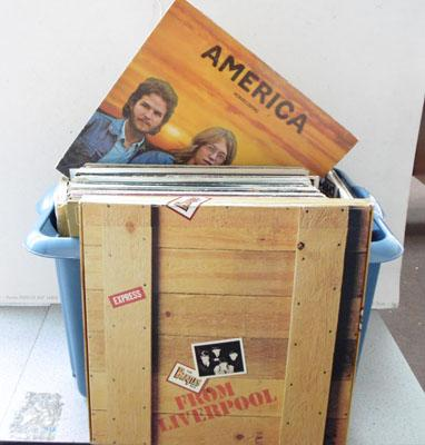 Box of LP records and Beatles books