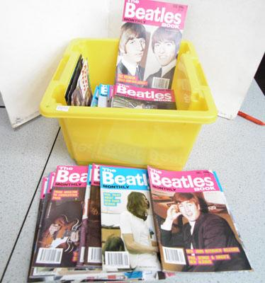 Box of Beatles monthly books and vinyls