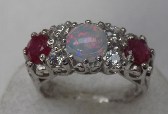 Silver opal + ruby set ring