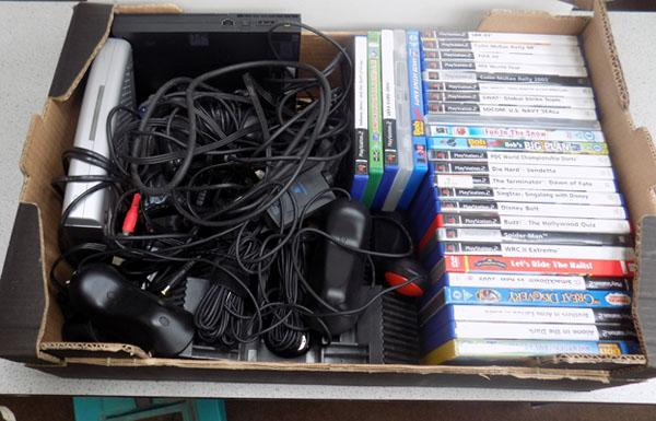 2 Playstation games/childrens DVDs/memory box etc.