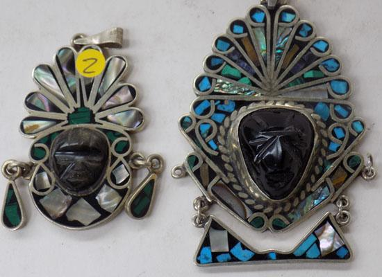 2 silver pendants Inca inspired contain turquoise/mother of pearl etc.
