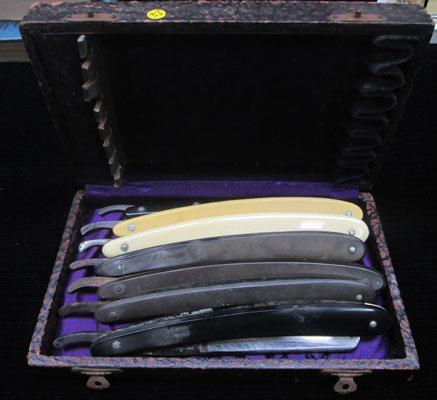 Box of vintage cut throat razors