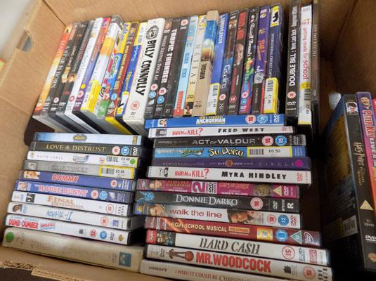 Box of mixed DVDs
