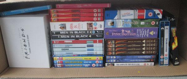 Box of various DVD box sets including Friends