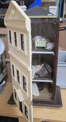 Old dolls house fully furnished with glass front