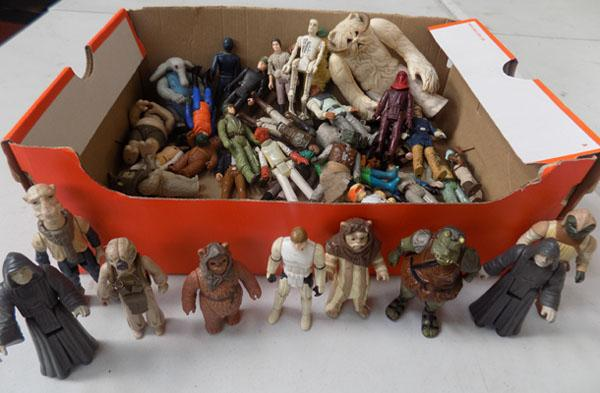 Box of vintage Star Wars figures from 1977-84