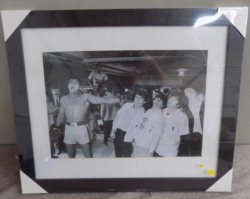 Framed picture of Mohammed Ali with The Beatles