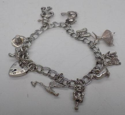 Charm bracelet with 10 charms & heart locket