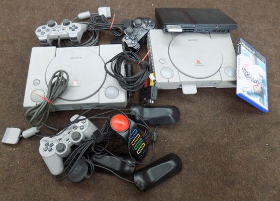 PS1 & PS2 with 1 game & controllers