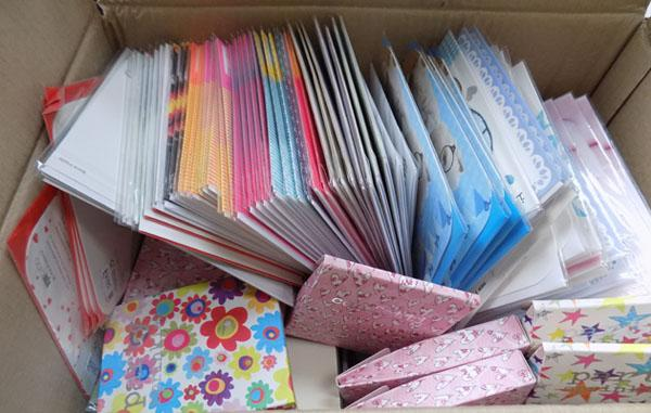 Box of new greeting cards etc