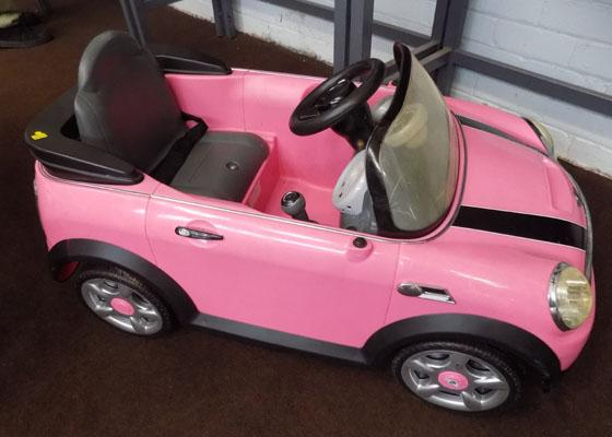 Child's electric pink Mini Cooper car (no charger)