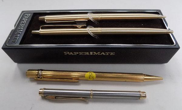 2 gold coloured papermate pens