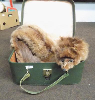 Suitcase and fox fur stole