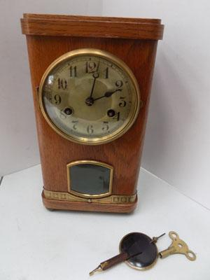 Oak cased mantle clock (key and pendulum in office)