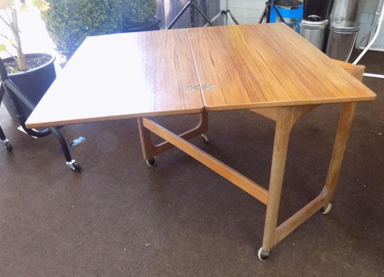 Fold out table on wheels