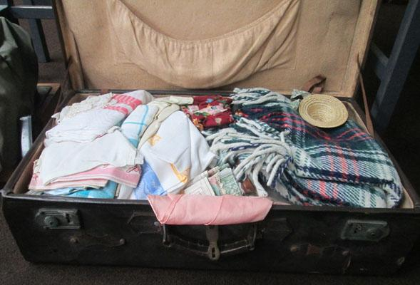 Suitcase full of vintage linen