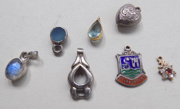 Assortment of pendants including silver