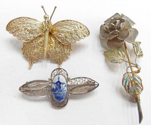 3x Silver brooches, butterfly, rose, delfware