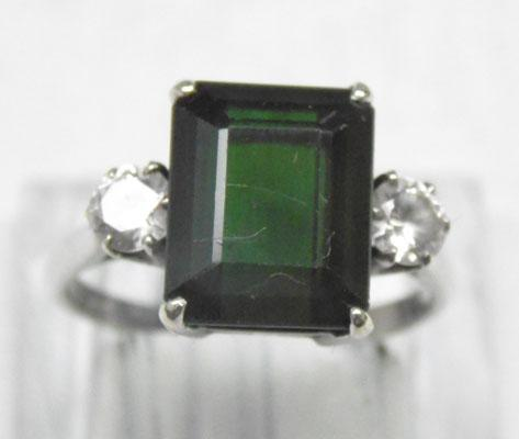9ct White gold ring with large green stone