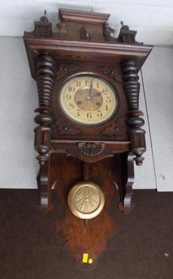 Ornate wooden wall clock