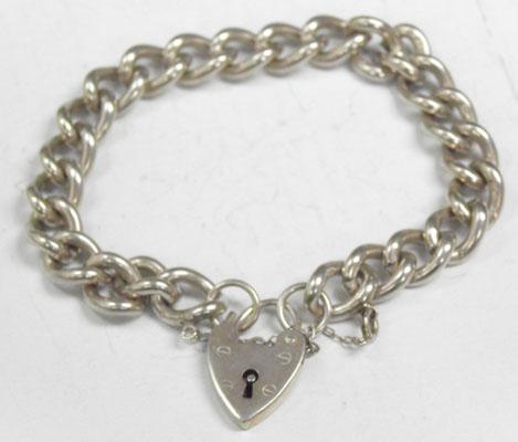 heavy solid silver bracelet with padlock fastener