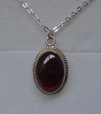 Sterling silver deep red garnet pendant on silver chain