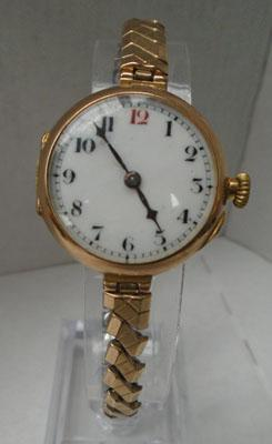 9ct Gold watch with rolled gold strap