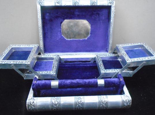 Large ornate silver coloured jewellery box