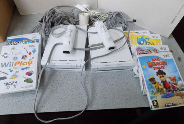 2x Wii console, 6 games & 2 remotes. missing sensors w/o