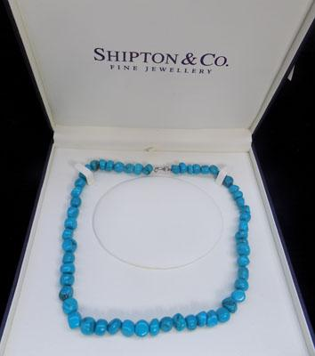 Turquoise necklace with silver clasp