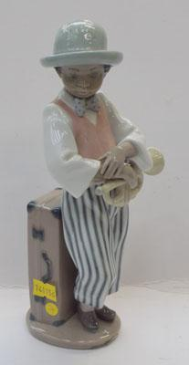 Lladro boy holding trumpet (slight damage)