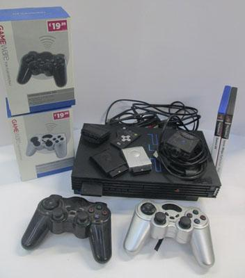 Playstation 2 with 2 controllers & 2 games