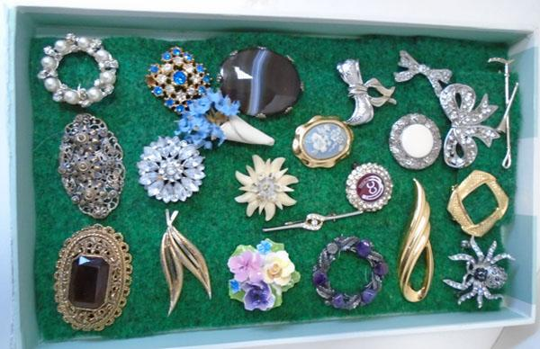 Tray of brooches