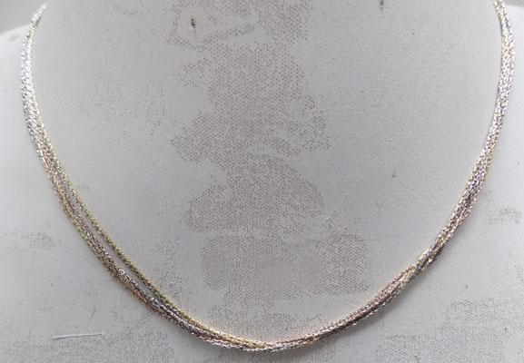 Triple gold toned sterling silver necklace