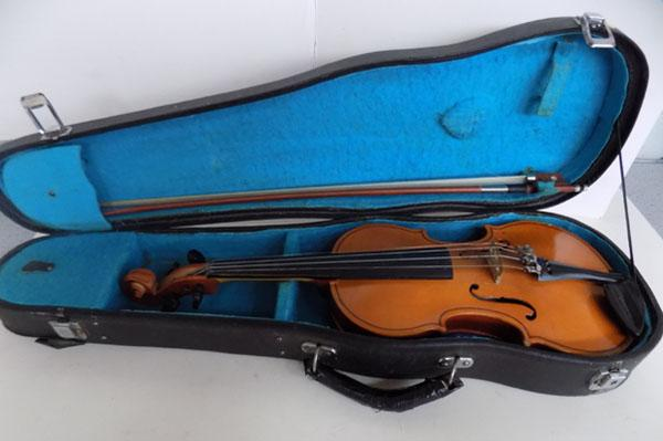 Childs violin in case
