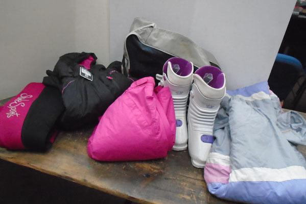 Sports wear including skiing outfir , boots and wetsuit