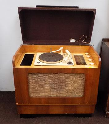 Vintage record player in cabinet