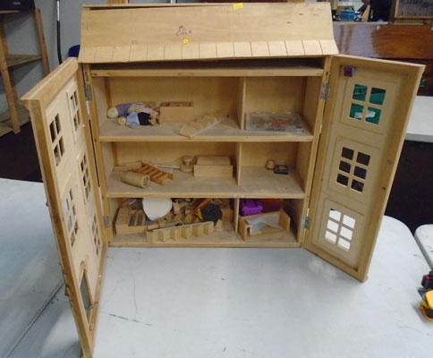 Large dolls house with some furniture