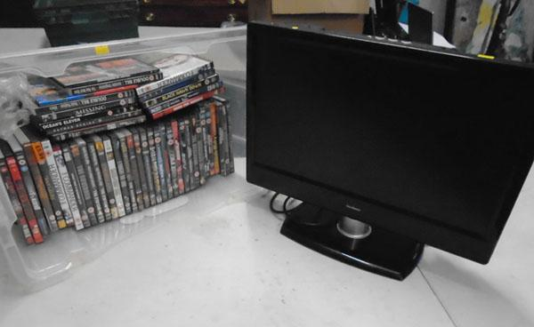Goodmans flatscreen HD Tv & large tub of DVD's w/o