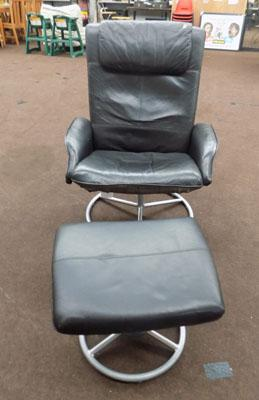 Black recliner chair with footstool